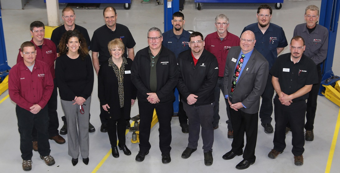 Bridgestone leaders Pat Graves (center, front) and Travis Koceja (right of Graves) joined FVTC faculty and others to celebrate a donation to automotive technology training.