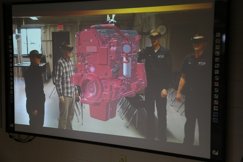 Members of our Learning Innovations team join instructors in testing a new virtual reality diesel engine.
