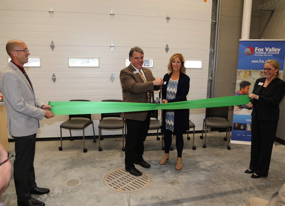 Tony Gonzalez, chair of the FVTC Board of Trustees, and Jackie Weber, president of the FVTC Foundation Board (center), cut the ribbon to dedicate the new Wautoma Regional Center.